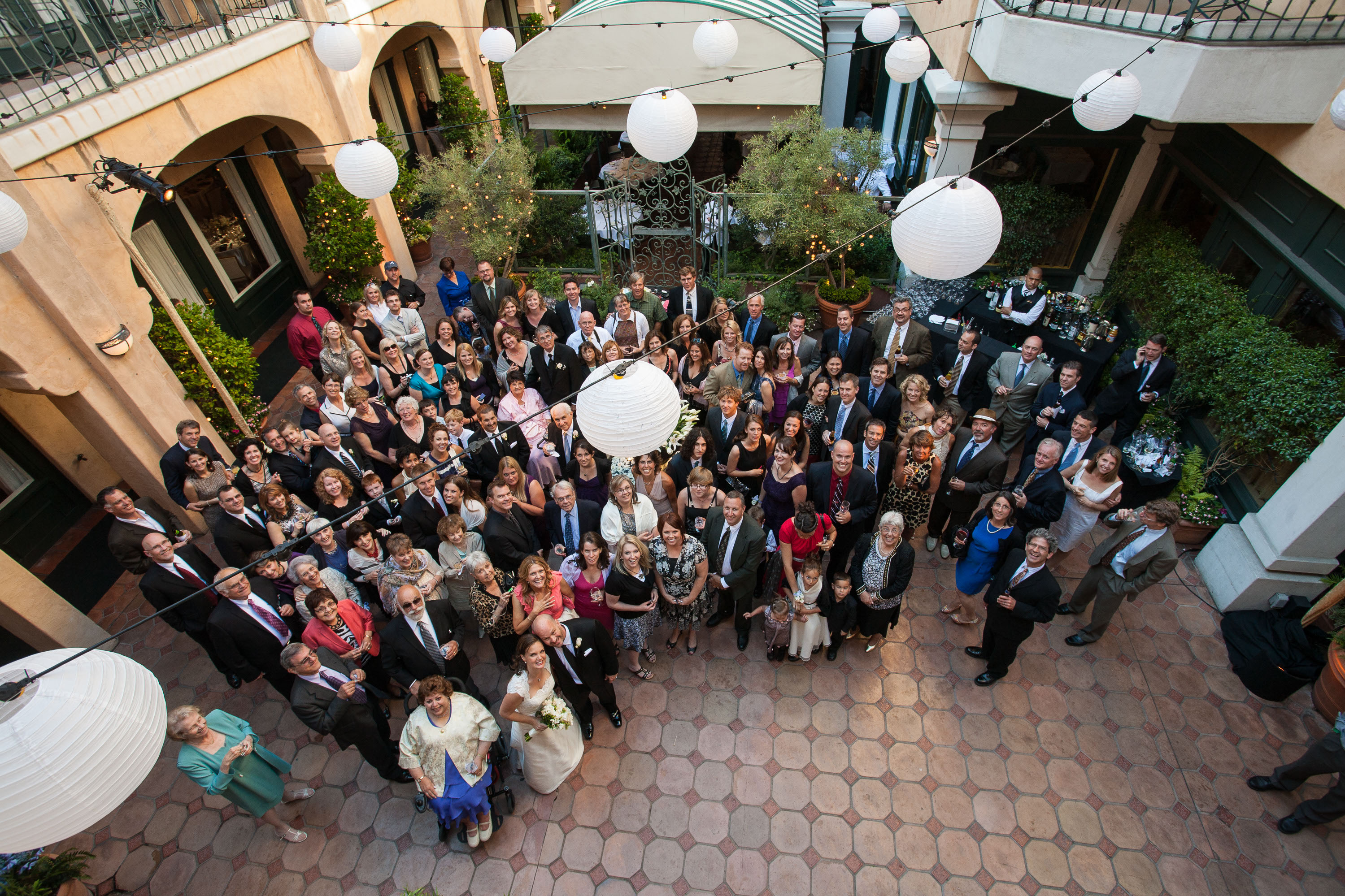 The Bride And Groom Surrounded By Their Entire Assembled Guests In The  Courtyard Of The Garden