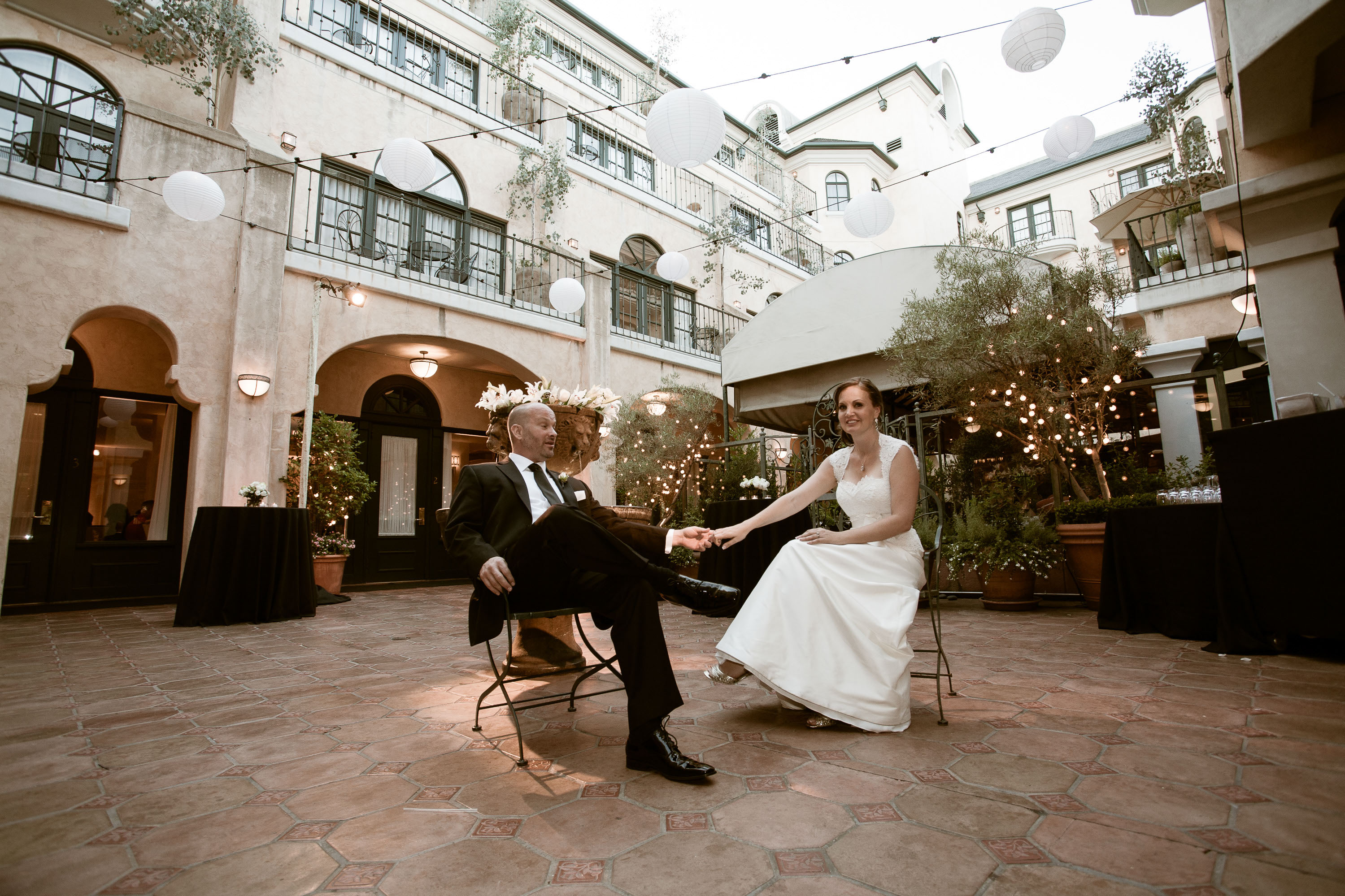 The Bride And Groom Relax Together In The Courtyard At The Garden Court  Hotel In Palo